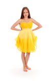 Full body portrait of young woman in yellow dress. White background Royalty Free Stock Image