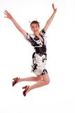 Full body pose of Japanese woman jumping high Royalty Free Stock Photos
