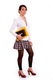 Full body pose of smiling young student with books Royalty Free Stock Photography