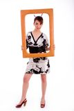 Full body pose of woman in kimono holding a frame Royalty Free Stock Photo