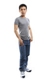 Full body pose of young fitness Asian man Stock Photo