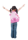 Full body rear view Asian child with schoolbag. Full body rear view Asian child elementary student with schoolbag arms outstretched standing isolated on white Royalty Free Stock Image