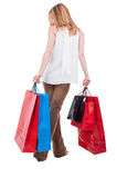 Full body of sexy customer with shopping bags Royalty Free Stock Photos