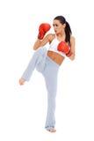 Full body shot of female kick boxer. Over white background Stock Photography