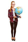 Full body shot of teacher. Full body shot of female teacher carrying a globe isolated on a white background royalty free stock photography