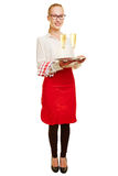 Full body shot of young woman as waiter Royalty Free Stock Image