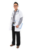 Full body southeast Asian medical doctor. Male medical doctor holding a clipboard standing on white background with confident smile Stock Photos
