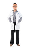 Full body southeast Asian medical doctor. Male medical doctor standing on white background with confident smile Royalty Free Stock Photo