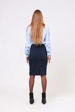 Full body studio shot from behind of young business woman on gra Stock Images
