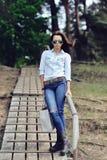Full body of stylish brunette woman outdoor Stock Photo