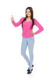 Full body woman showing thumbs up gesture Stock Photography