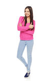 Full body woman showing thumbs up gesture Stock Photos