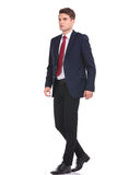 Full body of a young business man walking Stock Photos