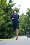 Full body of a young man jogging Royalty Free Stock Photography