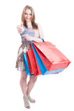 Full body of young shopaholic doing like gesture Stock Photo