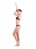 Full body of a young woman in a grey bikini Stock Photography