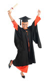 Full bodyMuslim university student jumping Royalty Free Stock Photography