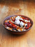Full bowl of different haricot beans, red hot peppers and garlic Royalty Free Stock Images
