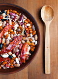 Full bowl of different haricot beans and red hot peppers Royalty Free Stock Photo