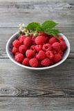 Full bowl of fresh  raspberries. Food close-up Royalty Free Stock Photo