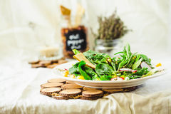 Full bowl of fresh salad with baby spinach, corn and crispy crac Stock Photos