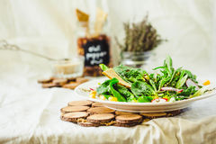 Full bowl of fresh salad with baby spinach, corn and crispy crac Royalty Free Stock Image