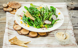 Full bowl of fresh salad with baby spinach, corn and crispy crac Stock Image
