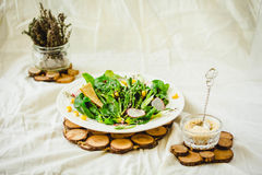 Full bowl of fresh salad with crispy crackers. Summer food and d Stock Photos