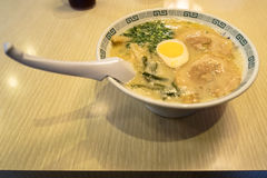Full bowl of japanese chashu ramen with half boiled egg, wagame, Royalty Free Stock Photo
