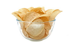 Full bowl with potato chips isolated on white Stock Photos