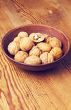 Full bowl of walnuts Stock Images