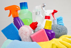 Full box of cleaning supplies and gloves Royalty Free Stock Photos