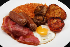 Full breakfast. Typical full english breakfast consisting of Sausage, bacon, egg, mushrooms, hash browns, beans and Fried Tomato Stock Photography