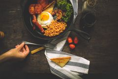 An English breakfast is a breakfast meal that typically includes bacon, sausages, eggs .. A full breakfast is a breakfast meal that typically includes bacon Stock Photos