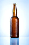 Full brown bottle with condensation Royalty Free Stock Photos