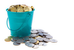 A full bucket of coins Royalty Free Stock Images