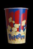 Full bucket of popcorn. Isolated on black background. Royalty Free Stock Images