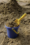 The full bucket of sand with scoop Stock Photography