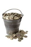 Full bucket of silver coins. Old zinc bucket with silver coins. Isolated royalty free stock photo