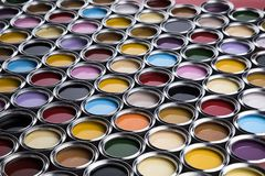 Colorful paint cans set. Full Buckets of rainbow colored oil paint royalty free stock images