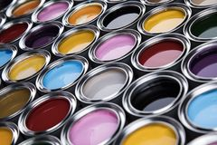 Colorful paint cans set. Full Buckets of rainbow colored oil paint stock image