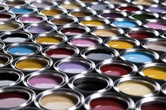 Colorful paint cans set. Full Buckets of rainbow colored oil paint royalty free stock photography