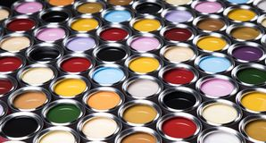 Colorful paint cans set. Full Buckets of rainbow colored oil paint stock photo