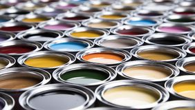 Colorful paint cans set. Full Buckets of rainbow colored oil paint stock photography