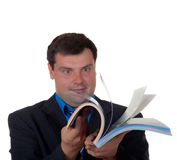 Man thumbs through the catalog Stock Photo