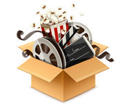 Full cardboard box filled cinema and filmmaking. Equipment cinefilms. Director`s firecracker, disk with reel, isolated on white background. Eps10 vector Stock Photo