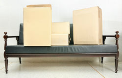 Full of cardboard boxes on a sofa Stock Images