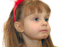 Full cheeks. Portrait of a 4 year old girl with her cheeks full Stock Photo