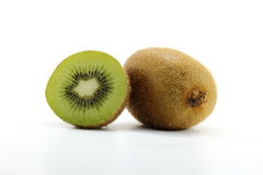 Full And Cleaved Kiwi Fruits On White Background Royalty Free Stock Photography