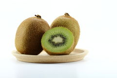 Full And Cleaved Kiwi Fruits On White Background Royalty Free Stock Images